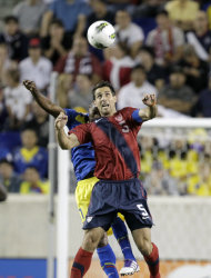 United States defender Carlos Bocanegra, front, and Ecuador forward Michael Arroyo go up for the ball in the first half of an international soccer friendly game, Tuesday, Oct. 11, 2011, in Harrison, N.J. (AP Photo/Julio Cortez)