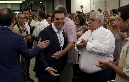 Greek former Prime Minister Tsipras is welcomed by members of his Syriza party during a meeting in Athens