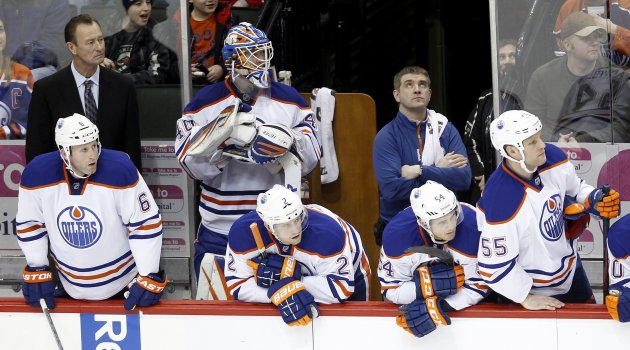 Edmonton Oilers goalie Devan Dubnyk watches the final minutes of the Oilers' NHL hockey game against the Minnesota Wild in St. Paul