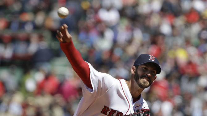 Boston Red Sox's Rick Porcello delivers a pitch against the Baltimore Orioles during the first inning of a baseball game Sunday, April 19, 2015, in Boston. (AP Photo/Steven Senne)