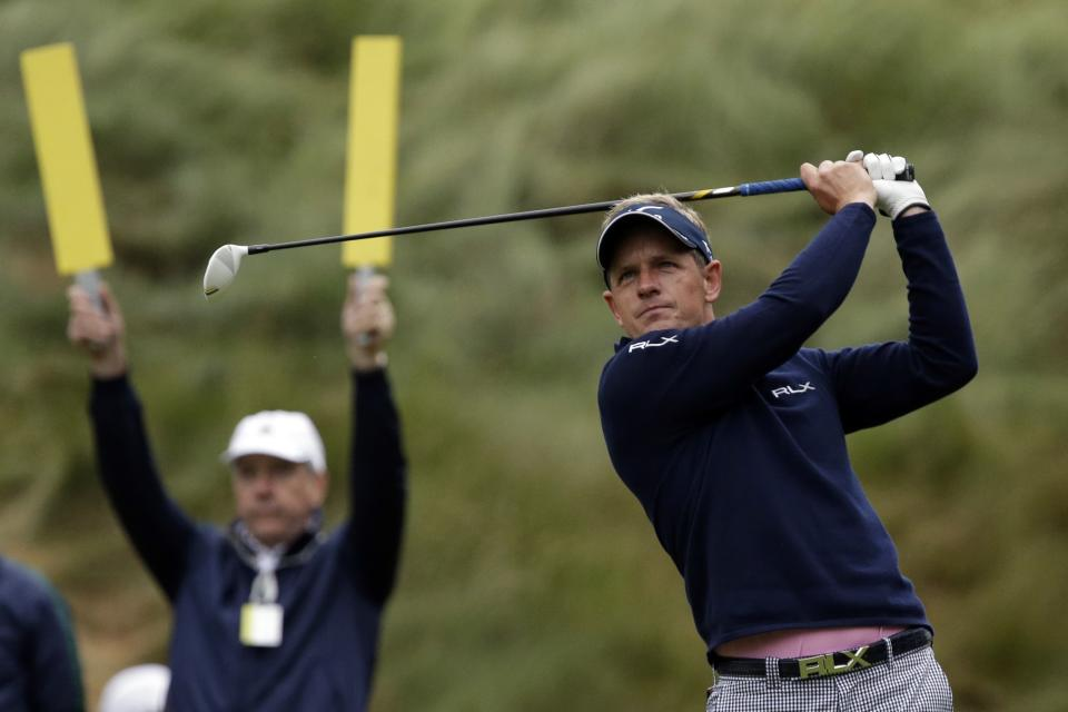 Luke Donald, of England, tees off on the 18th hole during the first round of the U.S. Open golf tournament at Merion Golf Club, Friday, June 14, 2013, in Ardmore, Pa. (AP Photo/Gene J. Puskar)