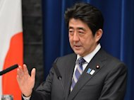 Japanese Prime Minister Shinzo Abe speaks during a press conference at the prime minister&#39;s official residence in Tokyo on March 11, 2013. Abe said Friday that Japan wants to take part in talks aimed at forging a huge free trade agreement that could involve 40 percent of the world&#39;s economy