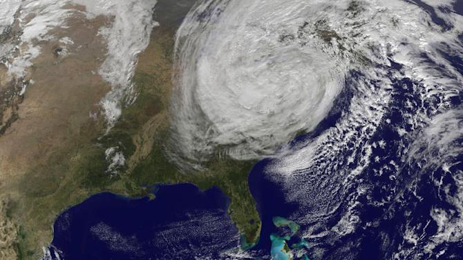 This handout photo provided by NOAA, taken Tuesday, Oct. 30, 2012, shows post-tropical storm Sandy off the East Coast of the US. Campaign 2012 is rich with images that conjure the seriousness and silliness that unfold side-by-side in any presidential race. Who could have predicted that a superstorm would overshadow and scramble the presidential campaign in its final days? President Barack Obama and Mitt Romney revised and re-revised their campaign schedules as Hurricane Sandy, a most unlikely October surprise, barreled up the East Coast and then roared ashore in New Jersey.  (AP Photo/NOAA)
