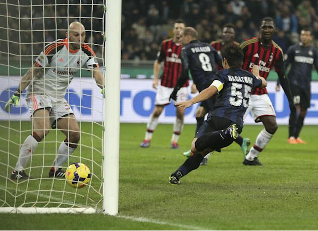 AC Milan goalkeeper Christian Abbiati, left, looks at the ball heading into the net as Inter Milan forward Rodrigo Palacio scores, during the Serie A soccer match between Inter Milan and AC Milan at t