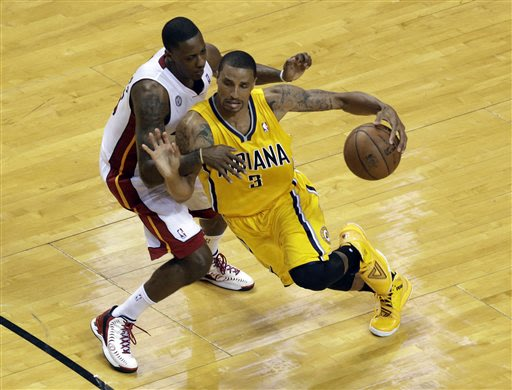 Indiana Pacers guard George Hill (3) drives against Miami Heat guard Mario Chalmers (15) during the second half of Game 1 in their NBA basketball Eastern Conference finals playoff series, Wednesday, M