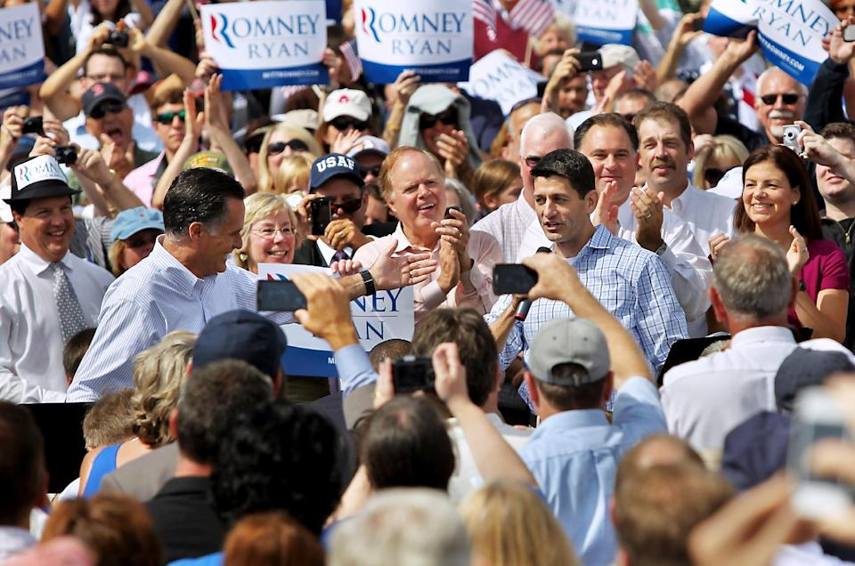 Republican presidential candidate, former Massachusetts Gov. Mitt Romney , left, introduces vice presidential candidate, Rep. Paul Ryan, R-Wis., Monday, Aug. 20, 2012, at a town hall at Saint Anselm College in Manchester, N.H.  (AP Photo/Cheryl Senter)
