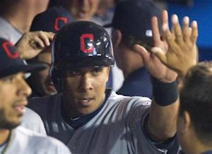 Cleveland Indians' Brantley is congratulated by teammates in the dugout after he scored in their MLB baseball game against the Toronto Blue Jays in Toronto
