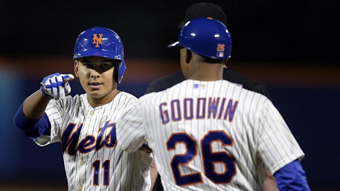 New York Mets' Ruben Tejada, left, reacts after hitting a single during the fifth inning of the baseball game against the Chicago White Sox at Citi Field on Tuesday, May 7, 2013 in New York. (AP Photo/Seth Wenig)