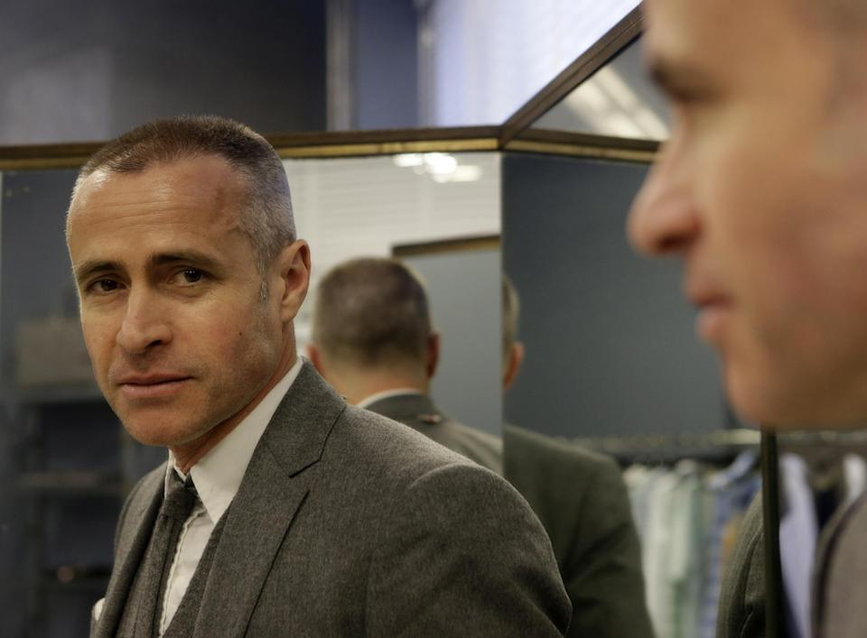 Fashion designer Thom Browne poses for a photograph in New York, Wednesday, Feb. 20, 2013. Browne is building a business _ and what he hopes is a smart, long-lasting business at that. He's just not the overzealous, mercurial artiste. (AP Photo/Kathy Willens)