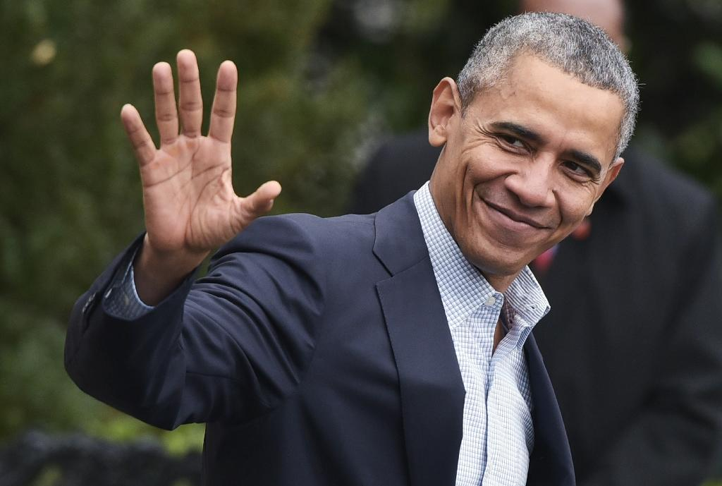 Obama lands in Paris with hope for climate change deal