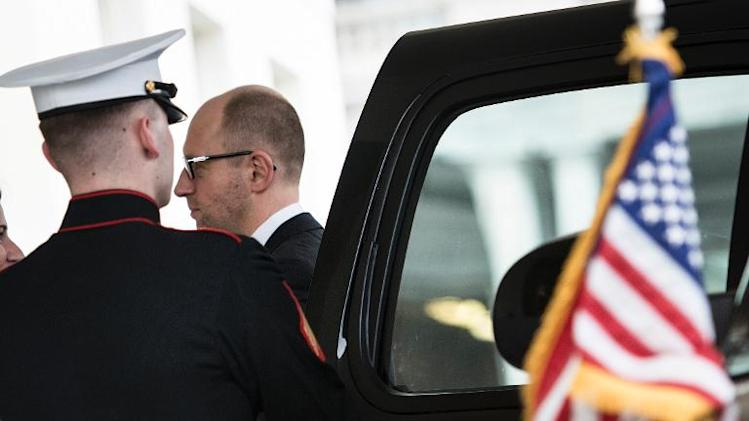 Ukrainian Prime Minister Arseniy Yatsenyuk arrives at the West Wing of the White House March 12, 2014 in Washington