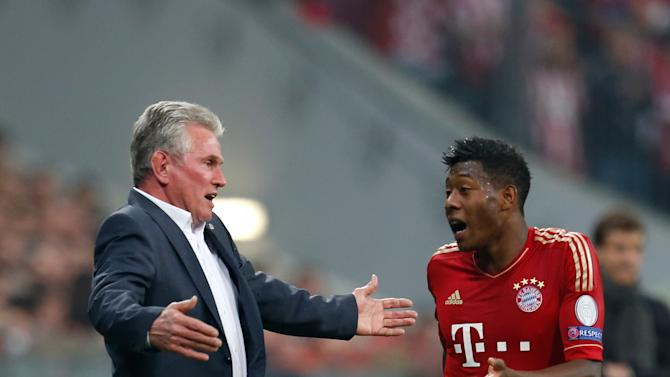Bayern's head coach Jupp Heynckes, left, gestures while talking to player  David Alaba, from Austria, during the Champions League semifinal first leg soccer match between Bayern Munich and FC Barcelona in Munich, Germany, Tuesday, April 23, 2013. (AP Photo/Matthias Schrader)