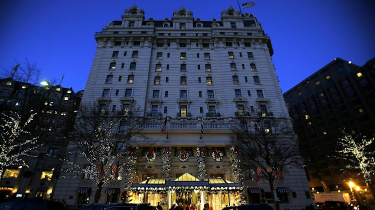 FILE - In this Wednesday, Dec. 19, 2012, file photo, the Willard Hotel is seen at dusk in Washington. At the Willard, about a block from the White House, rooms are still available for the presidential inauguration starting at more than $1,100 a night with a four night minimum. That means every guest will pay more than President Abraham Lincoln did when he checked out after his 1861 inauguration and paid $773.75 for a stay of more than a week. (AP Photo/Jacquelyn Martin)
