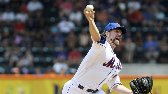 FILE - This Aug. 9, 2012 file photo shows New York Mets' R.A. Dickey pitching during the first inning of a baseball game against the Miami Marlins at Citi Field in New York. Dickey is a favorite to take home the AL Cy Young Award, Wednesday, Nov. 14, 2012. (AP Photo/Seth Wenig, FIle)