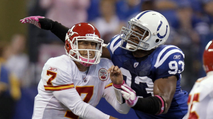 Indianapolis Colts defensive end Dwight Freeney, right, hits Kansas City Chiefs quarterback Matt Cassel as he follows through on a pass during the second half of an NFL football game in Indianapolis, Sunday, Oct. 10, 2010. The Colts defeated the Chiefs 19-9. (AP Photo/Michael Conroy)