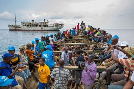 PLAN INTERNATIONAL handout photo shows refugees from Burundi and aid workers sailing on a boat to reach MV Liemba, a ship freighted by the United Nations at the Kagunga landing base on the shores of Lake Tanganyika near Kigoma in Tanzania
