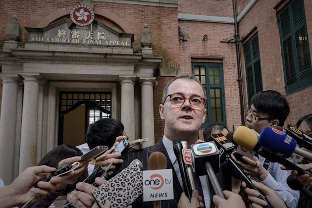 Michael Vidler, lawyer of a transsexual woman seeking to marry her boyfriend, talks to the press in Hong Kong on May 13, 2013. The woman has won a groundbreaking court appeal allowing her to marry her boyfriend and forcing the Hong Kong government to re-write the city's marriage laws