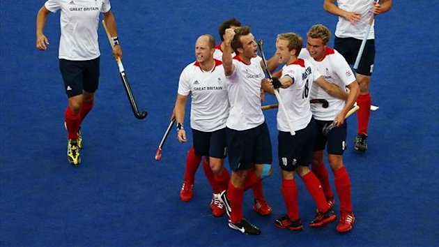 Britain's Barry Middleton (3rd R) celebrates his goal from a penalty corner with teammates during their men's Group A hockey match against Argentina at the London 2012 Olympic Games at the Riverbank Arena on the Olympic Park in London July 30, 2012.