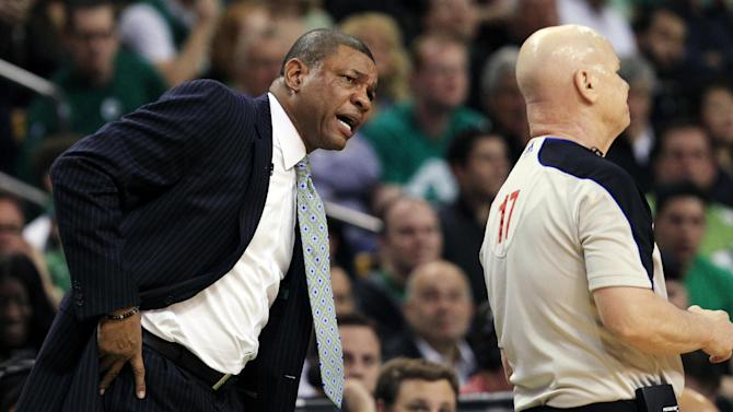 Boston Celtics head coach Doc Rivers, left, questions referee Joe Crawford (17) during the first quarter of Game 4 against the Miami Heat in their NBA basketball Eastern Conference finals playoff series in Boston, Sunday, June 3, 2012. (AP Photo/Elise Amendola)