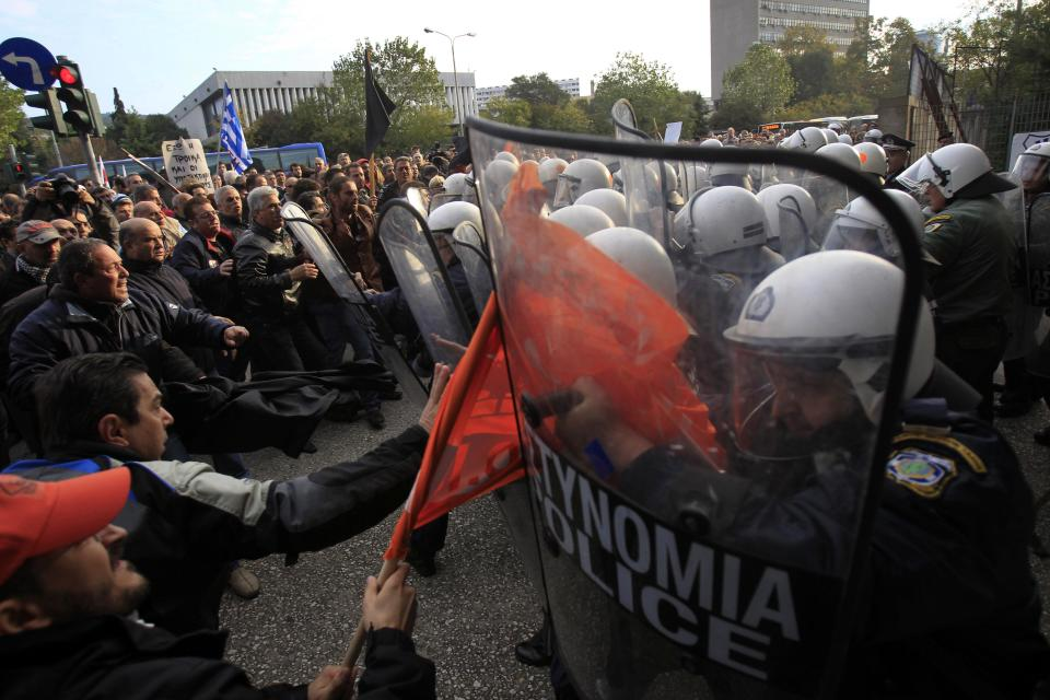 Protesters clash with police before a conference of Greek and German mayors in the northern Greek port city of Thessaloniki, Thursday, Nov. 15, 2012. Dozens of anti-austerity protesters broke into a conference and clashed with police to demonstrate against the presence of a German government official. (AP Photo/Nikolas Giakoumidis)