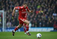 "Steven Gerrard (seen in Norwich in April) says he is confident Liverpool can get back on track after the disappointment of their opening Premier League game under new coach Brendan Rodgers. ""We have to put it behind us,"" he told the Liverpool Echo. Liverpool face Hearts in their Europa League play-off first leg on Thursday"