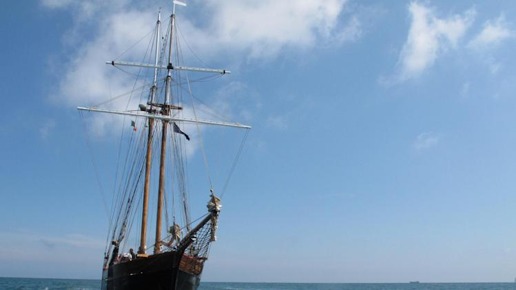 This May 17, 2013 photo shows a tall ship _ a replica of the vessels that historically carried millions of emigrants from Ireland _ sailing into Dublin port. The ship was participating in The Gathering, a yearlong tourism initiative to boost the country's economy by luring its diaspora home. (AP Photo/Helen O'Neill)