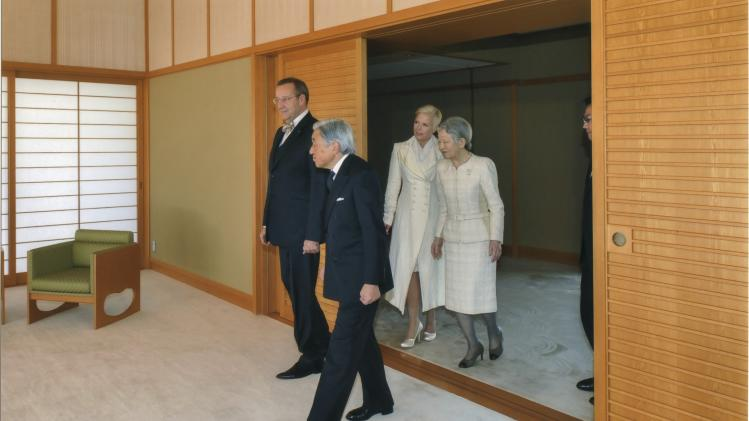Estonia's President Hendrik Ilves and his wife Evelin walk with Japan's Emperor Akihito and Empress Michiko at the Imperial Palace in Tokyo