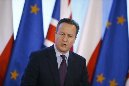 British Prime Minister Cameron addresses joint news conference in Warsaw