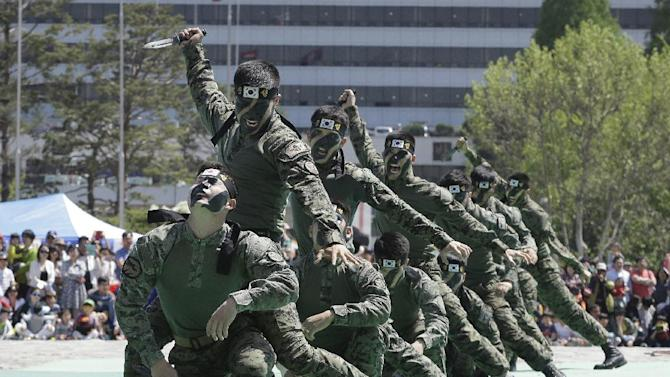 Soldiers from the South Korean army special forces demonstrate their skills how to fight back knife-wielding attackers during a martial arts demonstration for Children's Day at the War Museum in Seoul, Tuesday, May 5, 2015. May 5 is celebrated as Children's Day, a national holiday, in South Korea. (AP Photo/Ahn Young-joon)
