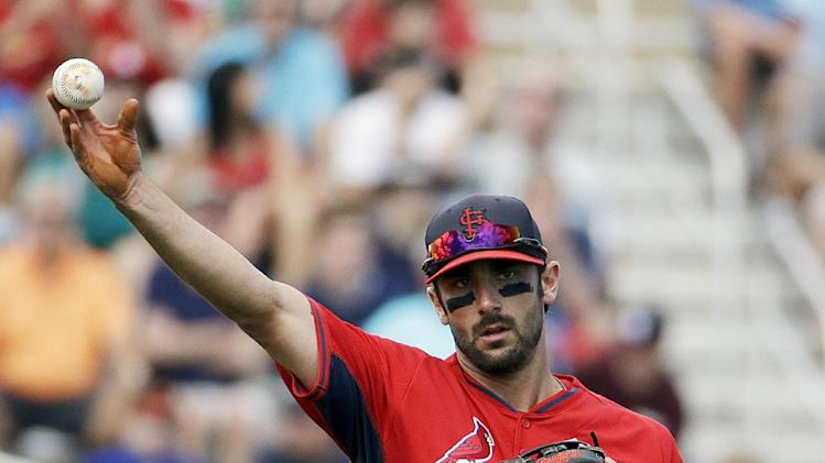 St. Louis Cardinals third baseman Matt Carpenter plays during an exhibition spring training baseball game against the Washington Nationals, Saturday, March 8, 2014, in Jupiter, Fla. (AP Photo/David Goldman)