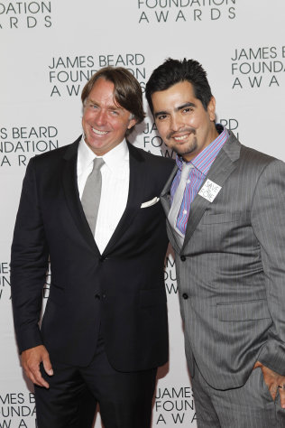 Chefs John Besh, left, and Aaron Sanchez arrive for the James Beard Foundation Awards, Monday, May 7, 2012, in New York. (AP Photo/Jason DeCrow)