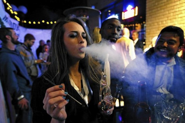 Patrons smoke marijuana at a Prohibition-themed New Year's Eve party in Denver -- Associated Press