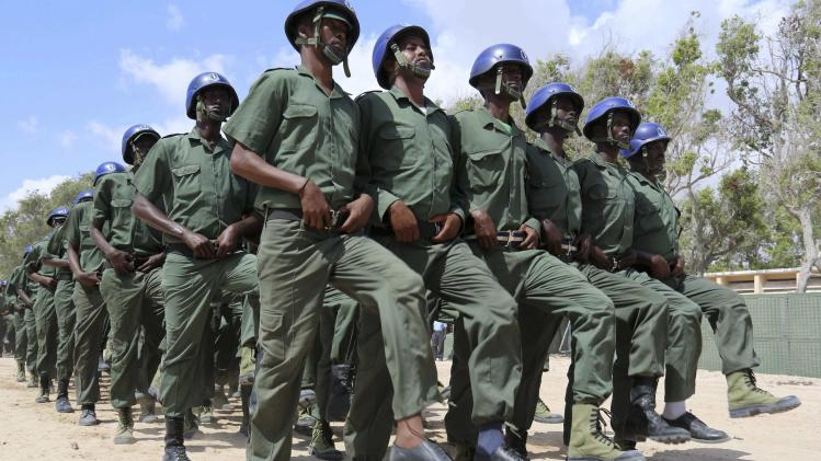 Somali policemen march in a passing out parade during celebrations to mark the Somali Police Force's 70th founding anniversary in Mogadishu