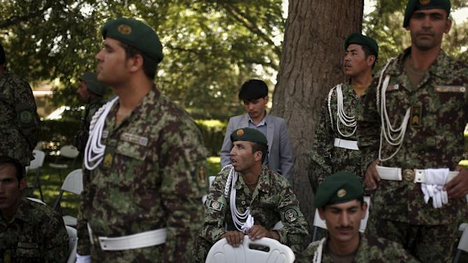 ANA soldiers attend a military funeral for ALP officers in Kabul