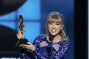 Taylor Swift accepts the award for top Billboard 200 album for &quot;Red&quot; at the Billboard Music Awards at the MGM Grand Garden Arena on Sunday, May 19, 2013 in Las Vegas. (Photo by Chris Pizzello/Invision/AP)