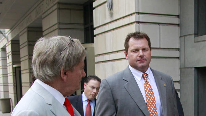 Former Major League Baseball pitcher Roger Clemens, right, and his lawyer Rusty Hardin, left, leave a federal court house, Wednesday, May 2, 2012, in Washington, as his retrial continues on charges of lying to Congress in 2008 when he said he had never used steroids of human growth hormone. . (AP Photo/Haraz N. Ghanbari)