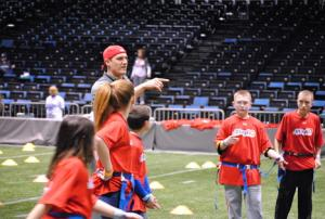 Indianapolis Colts TE Justin Snow gives instruction to kids on Jan. 27 during Play 60 at the NFL Experience.