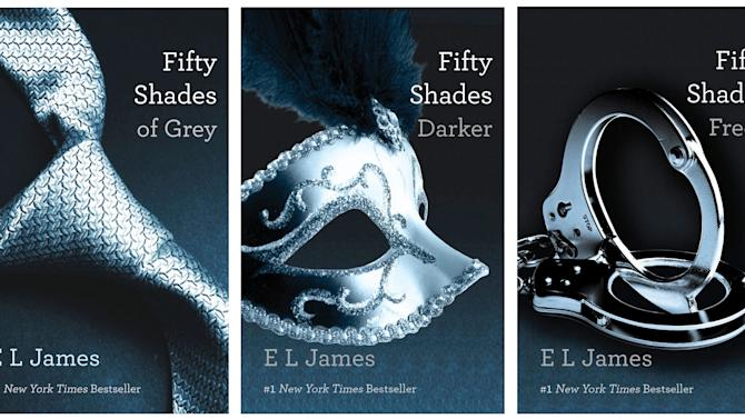 """FILE- This file combo made of book cover images provided by Vintage Books shows the """"Fifty Shades of Grey"""" trilogy by best-selling author E L James. EL James' erotic trilogy was easily the year's biggest hit, selling more than 35 million copies in the U.S. alone and topping bestseller lists for months. Rival publishers hurried to sign up similar books and debates started over who should star in the planned film version. Through James' books and how she wrote them, the general public was educated in the worlds of romance/erotica, start-up publishing and """"fan fiction."""" (AP Photo/Vintage Books, File)"""