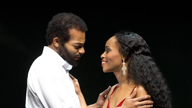 """This theater image released by Boneau/Bryan-Brown shows Brandon Victor Dixon as Berry Gordy, left, and Valisia LeKae as Diana Ross in """"Motown: The Musical,"""" performing at the Lunt-Fontanne Theatre in New York. (AP Photo/Boneau/Bryan-Brown, Joan Marcus)"""