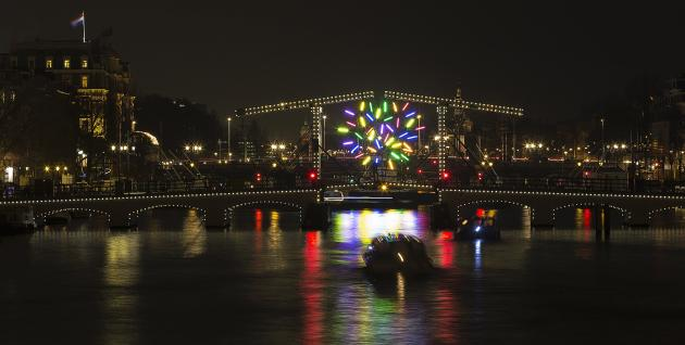 """Big Tree"" by French artist Jacques Rival is seen through the Magere brug as part of the Amsterdam Light Festival in Amsterdam"