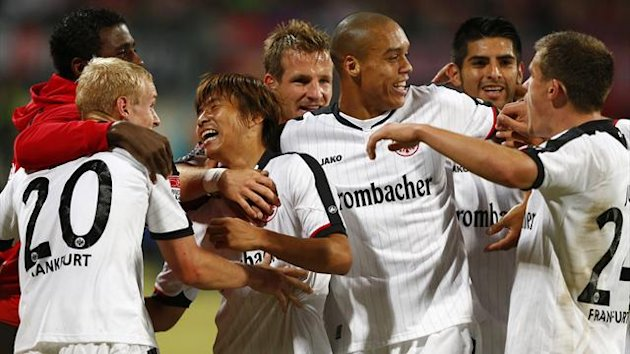 Japanese midfielder Takashi Inui (3rd L) of Eintracht Frankfurt celebrates his goal against FC Nuremberg with his teammates (Reuters)