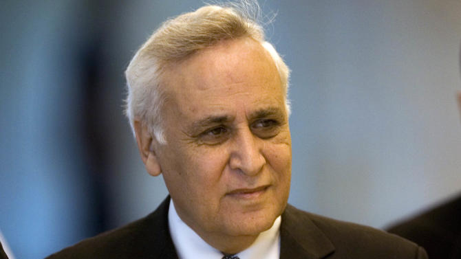 FILE - In this Nov. 10, 2011 file photo, Former Israeli President Moshe Katsav arrives at the Supreme court, in Jerusalem. President Shimon Peres' office announced Monday Oct. 15, 2012 that it has received a formal request to pardon his predecessor, Moshe Katsav, who is in jail after being convicted of sex crimes. (AP Photo/Sebastian Scheiner, File)