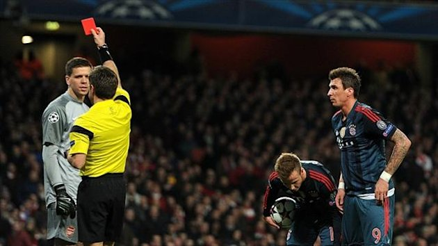 Wojciech Szczesny, left, is shown a red card by referee Nicola Rizzoli