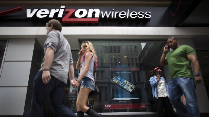 """Pedestrians pass a Verizon Wireless store on Canal Street, Thursday, June 6, 2013, in New York. The Obama administration on Thursday, June 6, 2013, defended the government's need to collect telephone records of American citizens, calling such information """"a critical tool in protecting the nation from terrorist threats."""" Britain's Guardian newspaper reported that the NSA has been collecting the telephone records of millions of Verizon customers under a top secret court order. (AP Photo/John Minchillo)"""