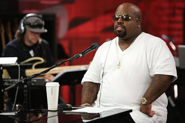 This image released by NBC shows CeeLo Green from the singing competition series &quot;The Voice,&quot; during a mentoring session in Los Angeles that aired on Oct. 8, 2012. NBC is shelling out big for attention-grabbing scripted series and for premiere sports events and shows like &quot;The Voice&quot; that invite live viewing to overcome ad skipping. (AP Photo/NBC, Tyler Golden)