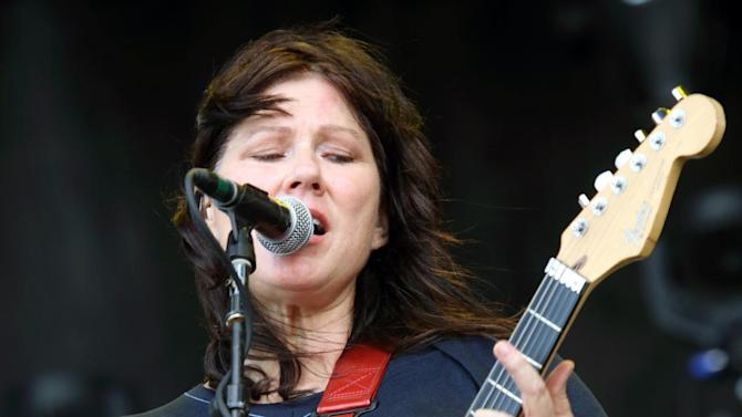 "FILE - This May 17, 2013 file photo shows Kim Deal of The Breeders performing at The Hangout Festival in Gulf Shores, Ala. Deal is no longer a member of the Boston-based group the Pixies. The band announced on its Facebook page Friday that the bassist has decided to leave the group after 25 years. The Pixies' rock hits include ""Monkey Gone to Heaven,"" ""Here Comes Your Man"" and ""Letter to Memphis."" They disbanded in the early 1990s and reunited in 2004. Deal is a part of the band The Breeders, which she formed and performs as lead singer and guitarist. (Photo by John Davisson/Invision/AP, file)"