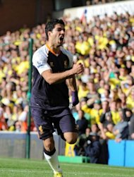 Liverpool's striker Luis Suarez celebrates scoring his second goal during their English Premier League football match against Norwich City at Carrow Road stadium in Norwich, England. Liverpool won 5-2