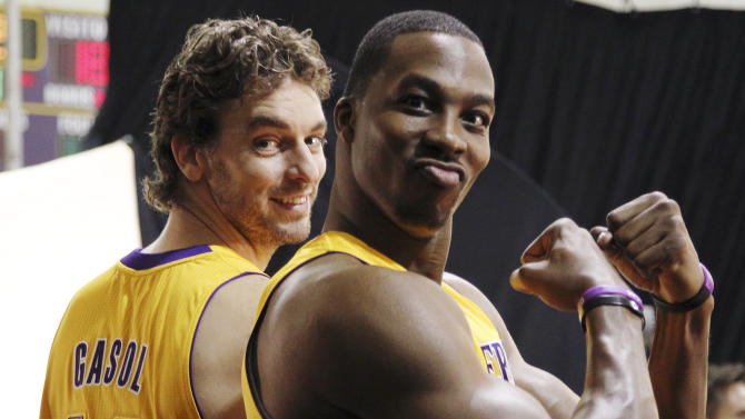 Los Angeles Lakers forward Pau Gasol (16) and center Dwight Howard pose during their NBA basketball media day at the team's headquarters in El Segundo, Calif., Monday, Oct. 1, 2012. (AP Photo/Reed Saxon)
