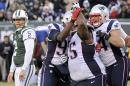 New York Jets kicker Nick Folk (2) watches as New England Patriots' Vince Wilfork (75) celebrates with teammates after Folk missed a field goal during the second half of an NFL football game Sunday, Dec. 21, 2014, in East Rutherford, N.J. (AP Photo/Bill Kostroun)
