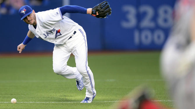 Toronto Blue Jays' Josh Donaldson fields the ball against Boston Red Sox during the first inning of a baseball game, Thursday, July 2, 2015, 2015 in Toronto.  (Frank Gunn/The Canadian Press via AP) MANDATORY CREDIT